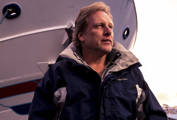 Sig Hansen is wearing a blue and grey jacket