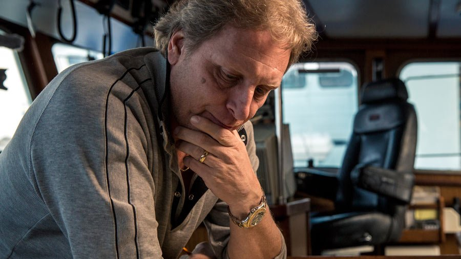 Sig HAnsen is keeping his hand on his jaw