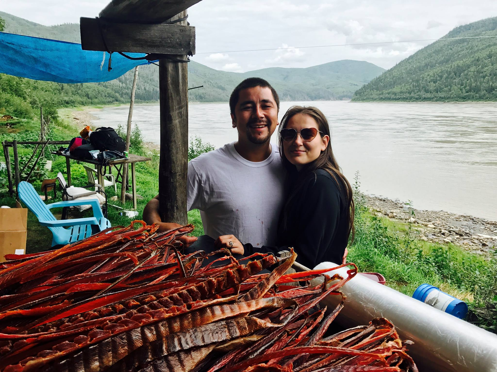 Joey Zuray and his girlfriend in the bank of the river