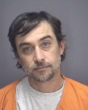 Steven Ray Tickle posing for a mugshot. He is wearing orange colored shirt.