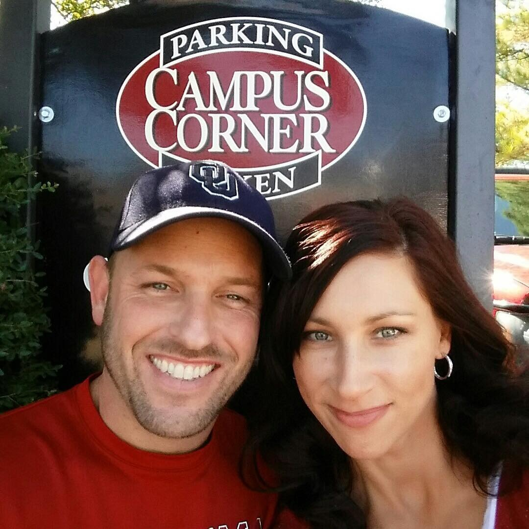 Jason Aker is enjoying happily with his wife. They are taking selfie with a smile on their face. Jason is wearing a blue cap and Red T-shirt.