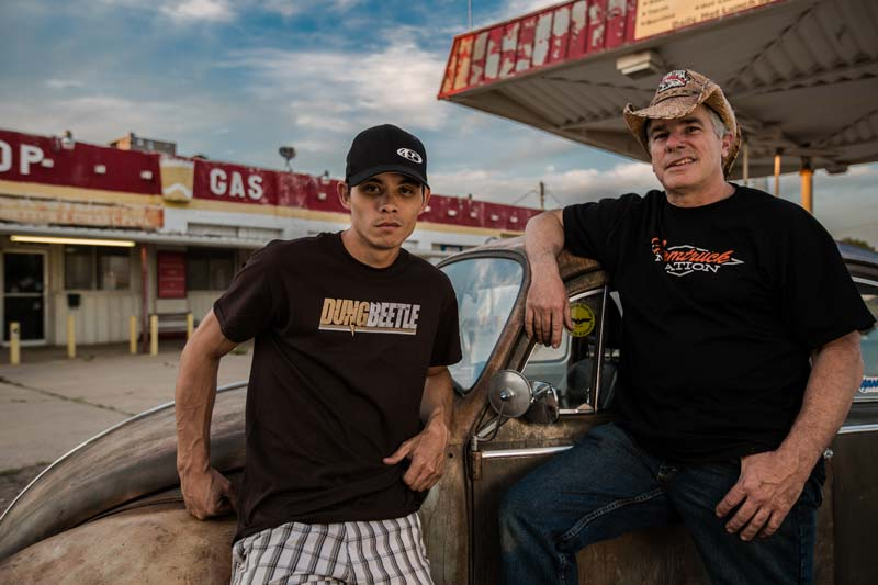 "Sean ""Farmtruck"" Whitley and  Jeff ""AZN"" Bonnett standing in front of rusty old car"