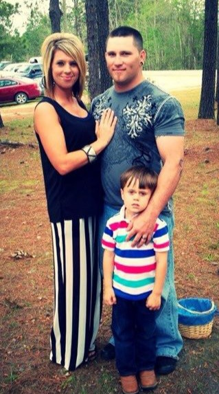Brandon Smith is seen with his wife and son