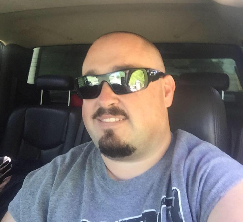 Derek Travis with a selfie inside his car.