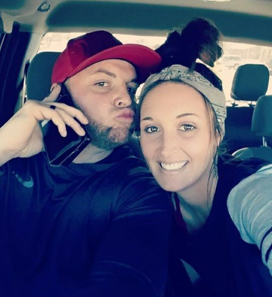 Gotee Bo poses off with a pout alongside his wife, Candace Burke Watkins in his car.