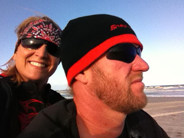 """James """"Reaper"""" Goad riding at Daytona Beach his wife Stacy Goad."""