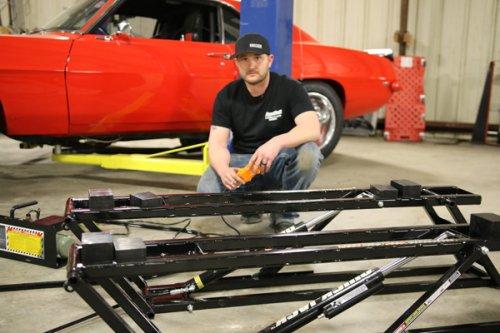Kye Kelley is working in car performance shop