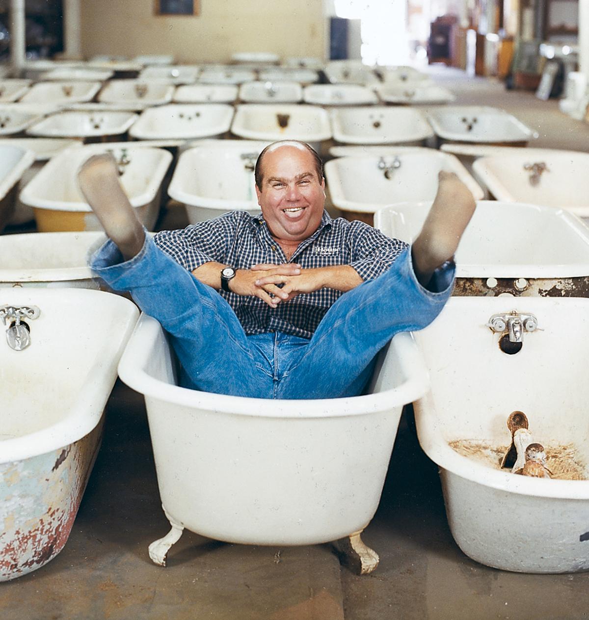Richard Trethewey  is sitting a bath tub giving silly pose