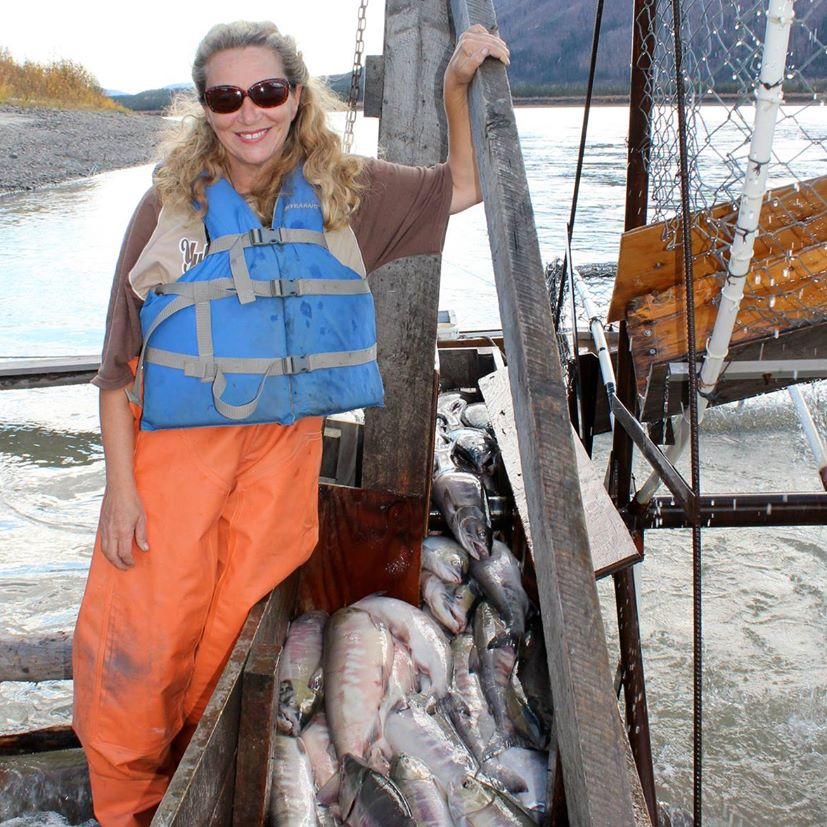 Kate Rorke posing for a picture wearing specs in a fish boat
