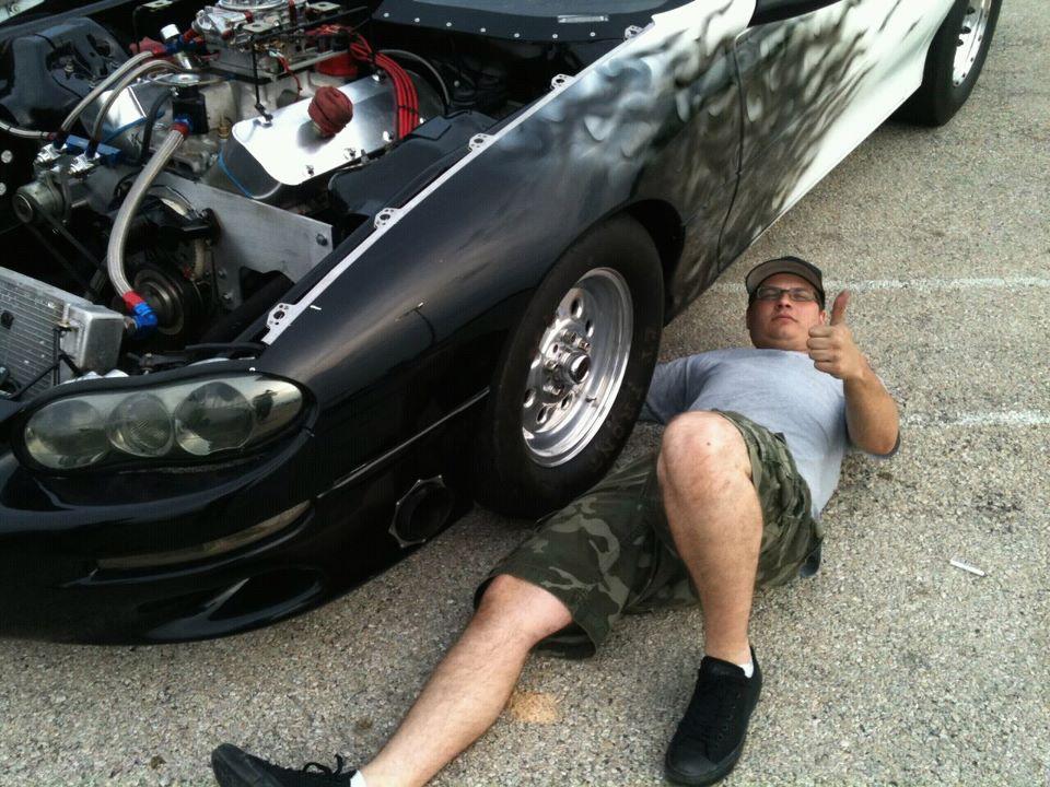 Dustin Bowen is under his 1999 Chevrolet Camaro.