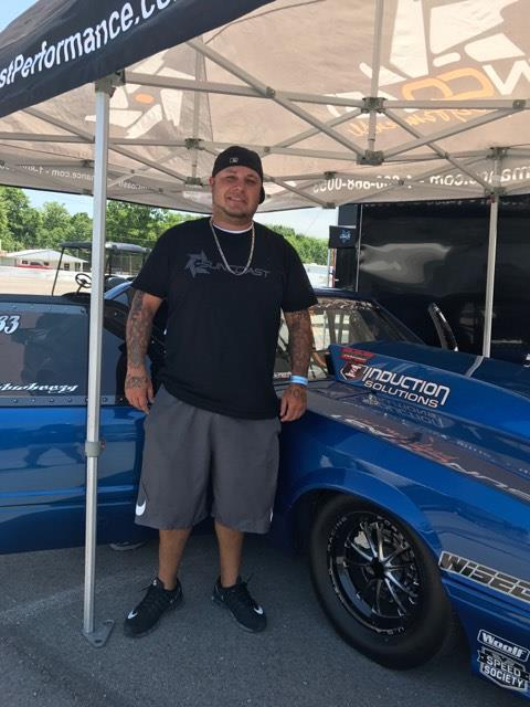 Bobby Ducote poses beside the blue 1986 Mustang better known as the new Lil' Legend.