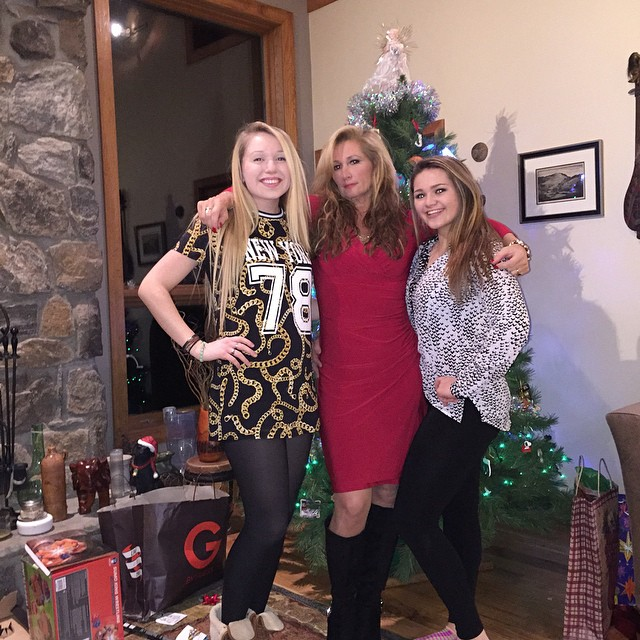 Joannie Kay with her daughter, Jessie and Sammy standing in front of Christmas tree