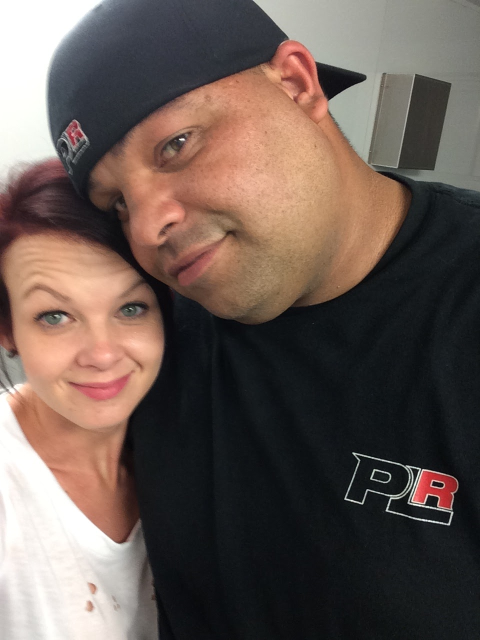 "Jose ""Freakin' Rican"" Rivera talking a selfie with his wife, Courtney Waltman"