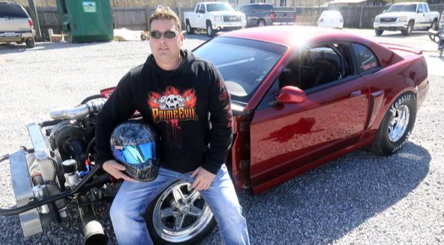 Shane Lester is sitting in the wheel of his Mustang Cobra aka Da Hellion.