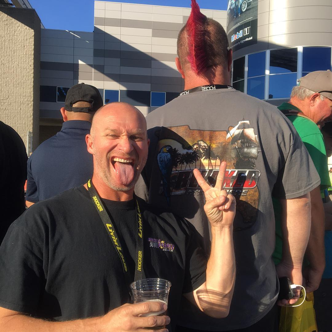 Joe Woods aka Dominator poses with a beer in his hand.