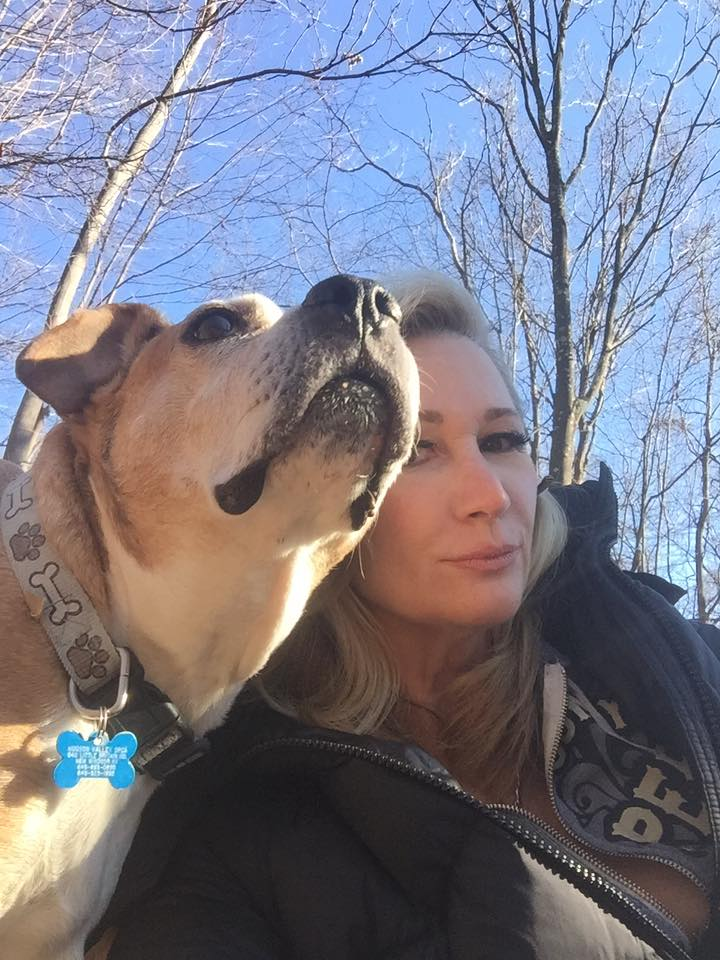 Joannie Kay taking a selfie with her dog