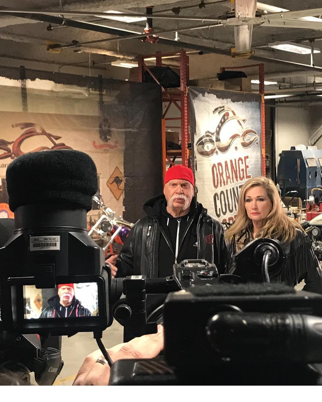 Joannie Kay and Paul Teutul Sr. at OCC in front of camera
