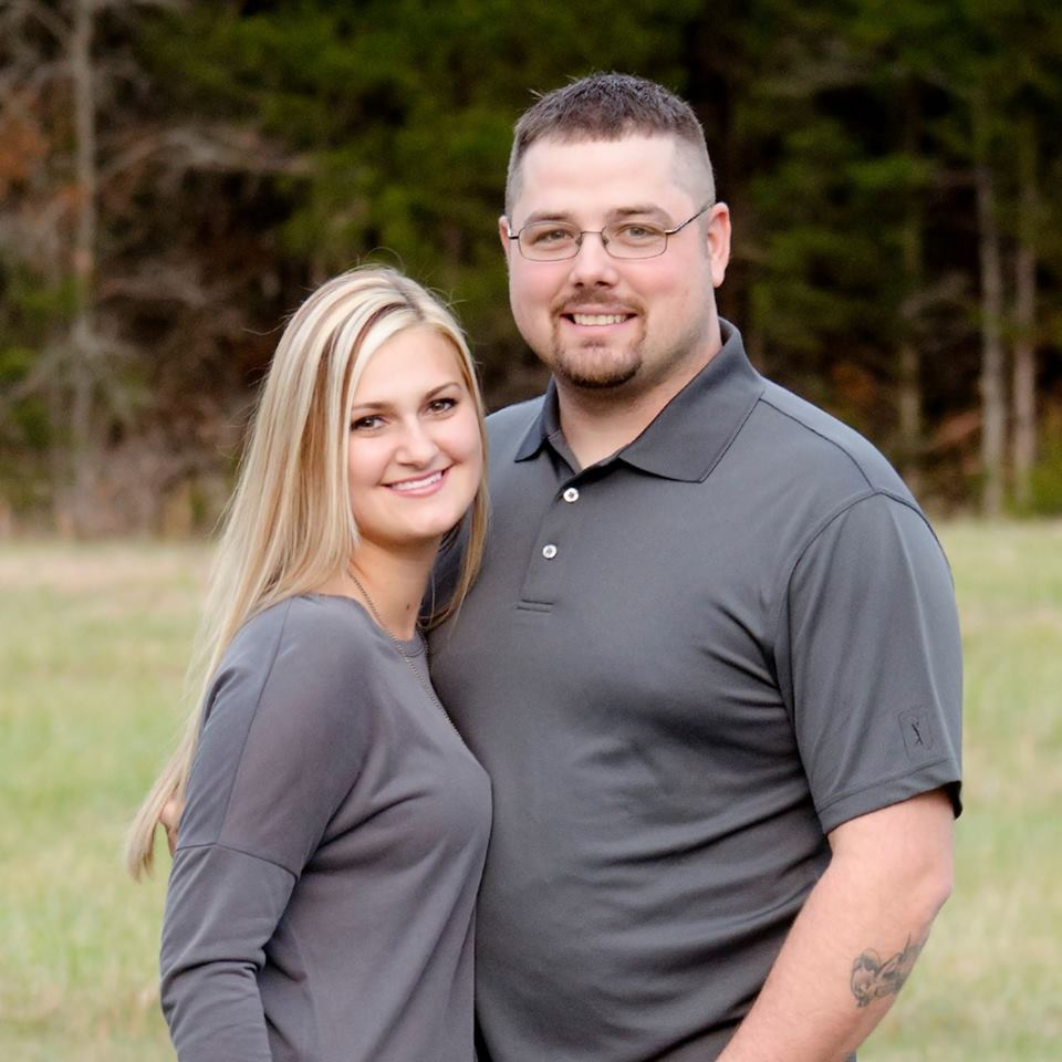 "Justin ""Racecar"" McDaniel wraps his arms around his wife, Krista Civey."
