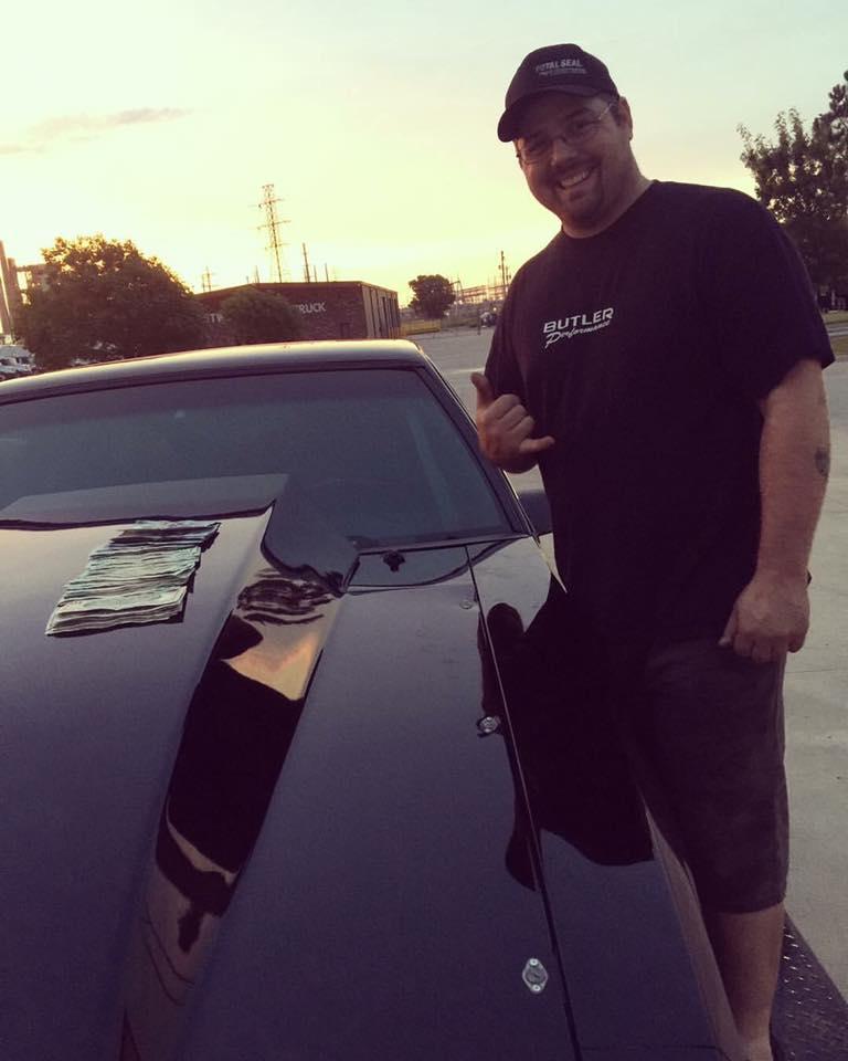 "Justin Racecar McDaniel is standing alongside his car, 598"" Big block Chevy Mustang."