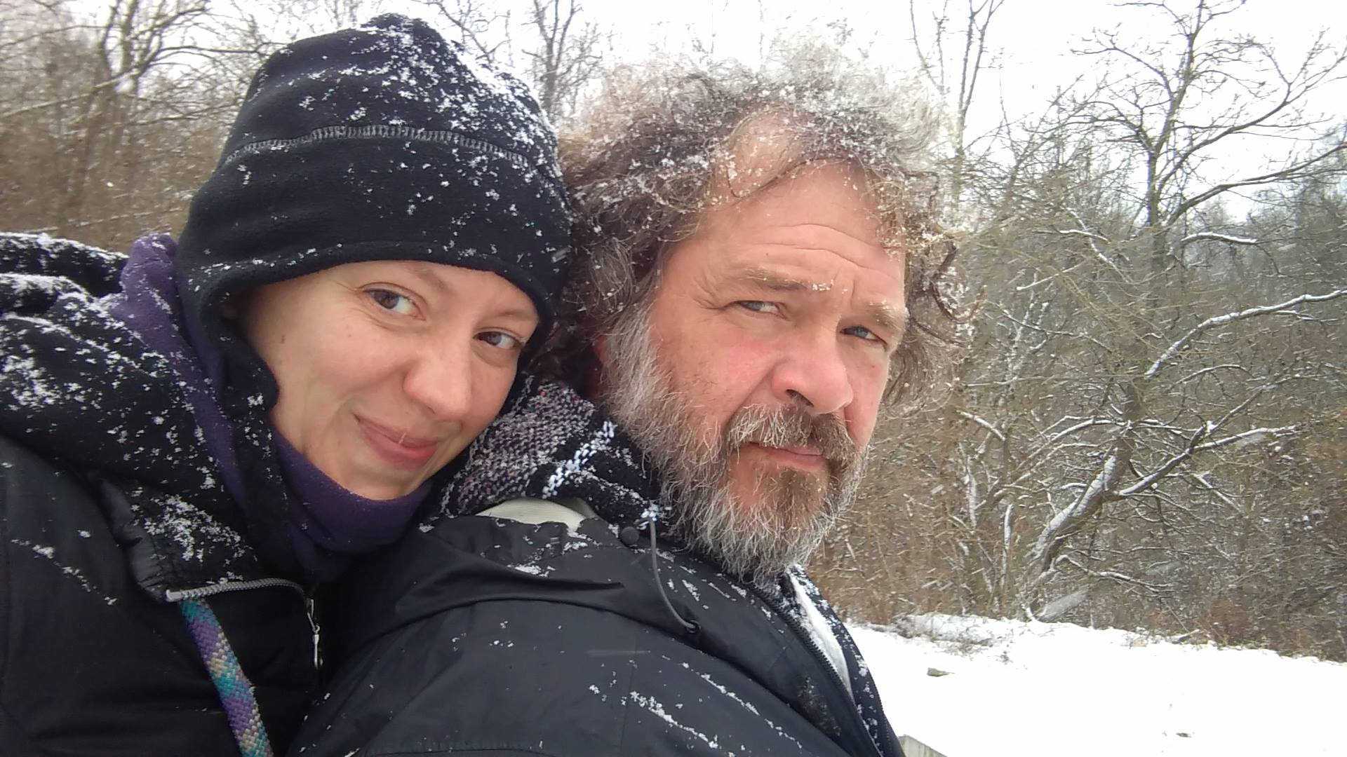 Mark Wacht and his wife Livvi Lantry-Wacht posing for pictures in snow