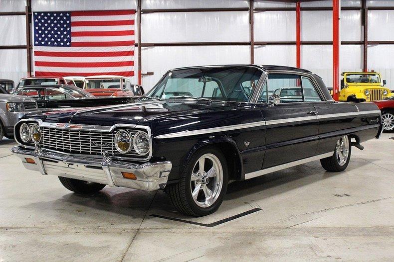 The sexy black 1964 model  Chevy Impala