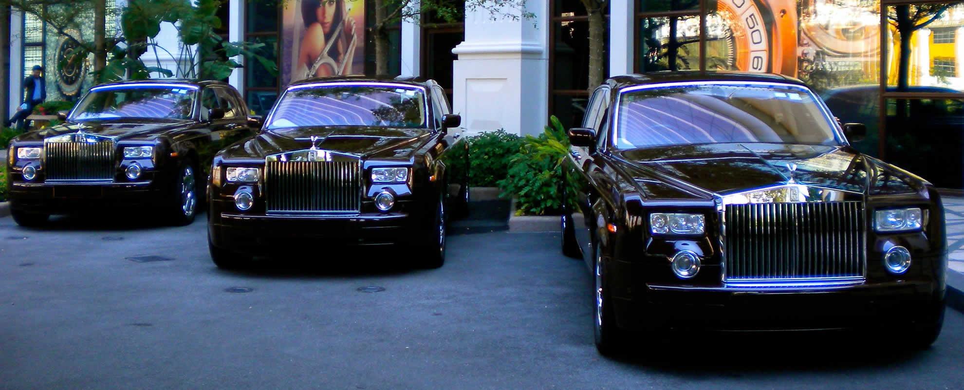 A high-profiled black Rolls Royce Phantom