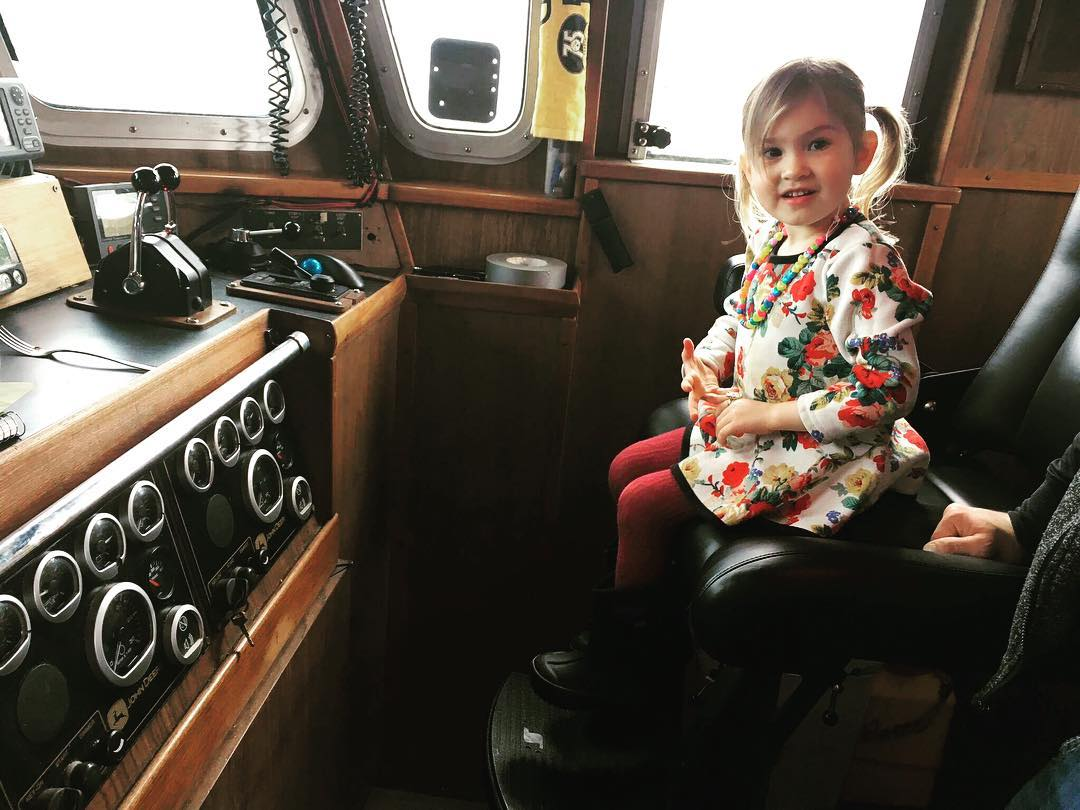 Nick McGlashan's daughter, Lennyn sitting on the captain's chair on F/V Summer Bay
