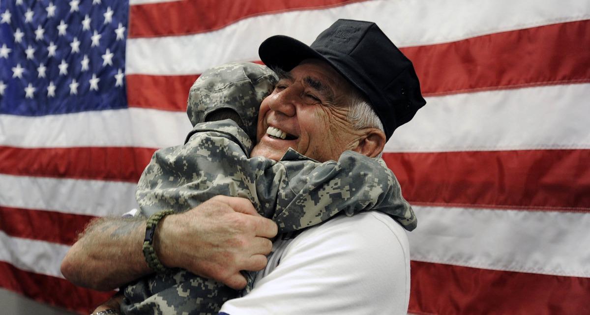 R. Lee Ermey is hugging a child