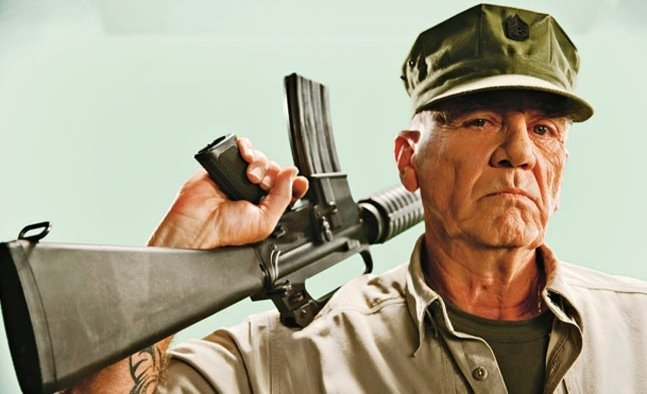 R. Lee Ermey is holding a gun in his soldier