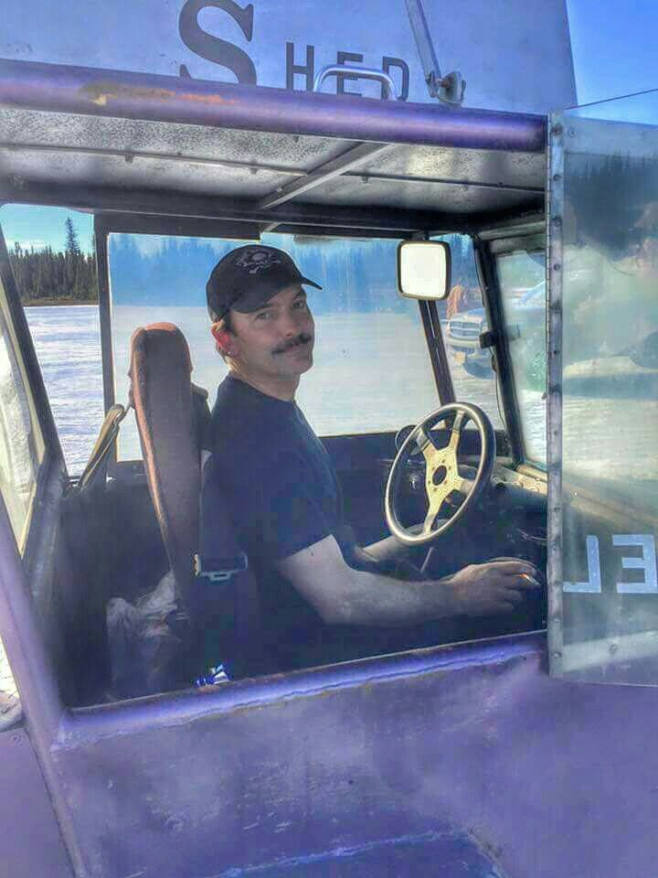 Neal Hillstrand poses from inside his vehicle.
