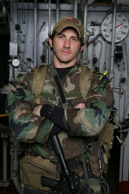 Wil Willis posing in the US Military uniform.