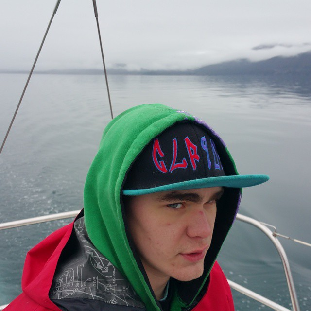 Phillip Hillstrand is wearing a green hoodie and a cap