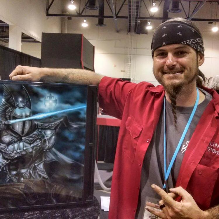 Ryan Evans poses with an amazing artwork.