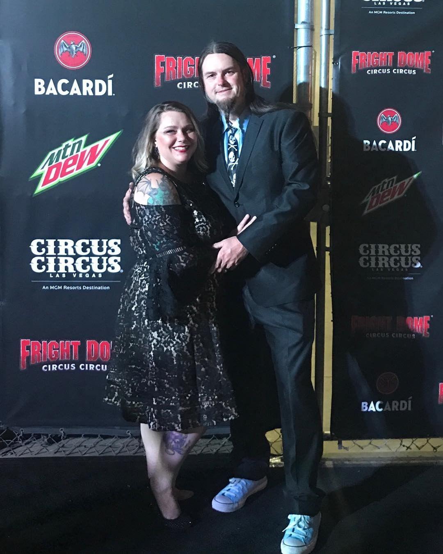 Ryan Evans alongside his wife, Dana Pauley at black carpet event.