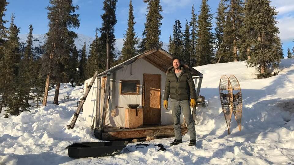 Glenn Villeneuve is outside his cabin
