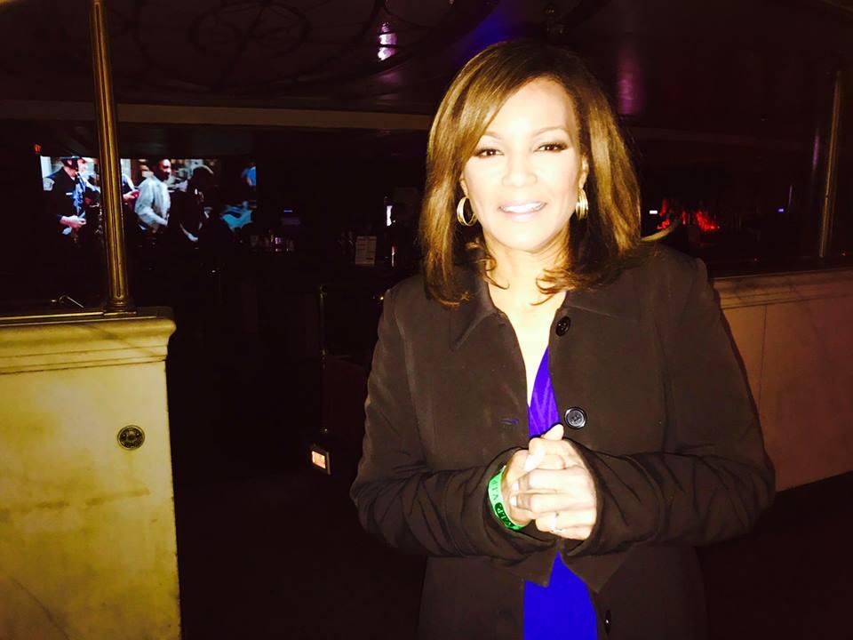 Carolyn Clifford is wearing black coat