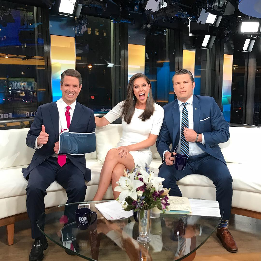 Griff Jenkins in the set of Fox 7 Friends with his  co-hosts, Pete Hegseth and Abby Hunstman