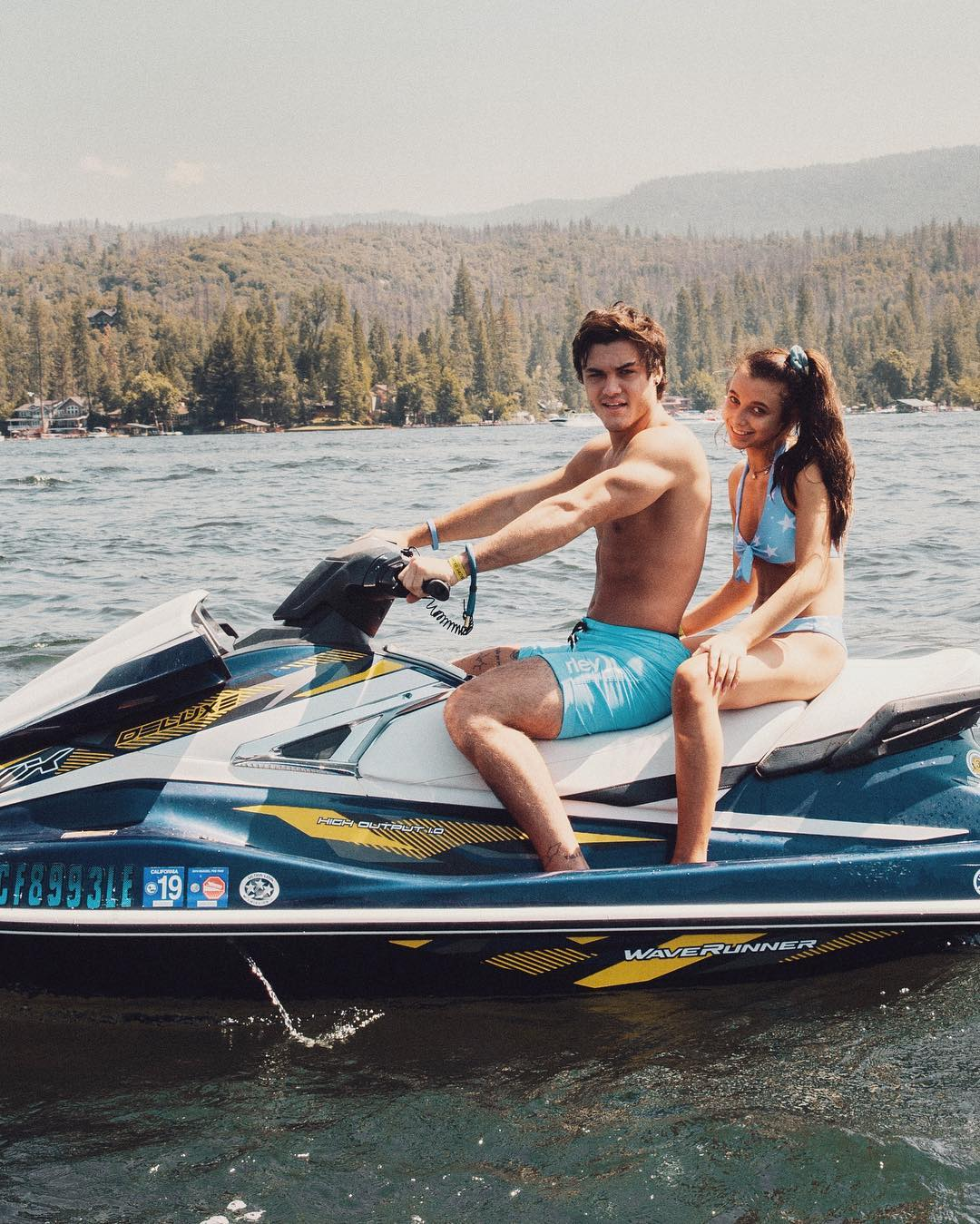 Ethan Dolan riding Waverunner with Emma Chamberlain in the back seat