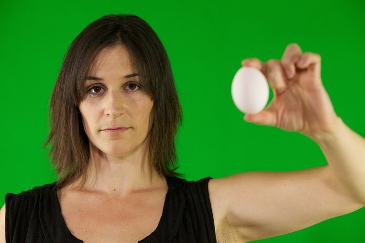 Melissa Hudson is holding a egg in her hand