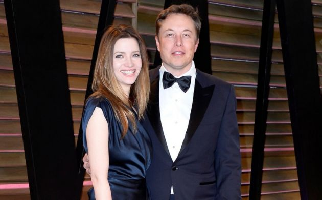 Talulah Riley and Elon Musk  are standing next to each other nad Elon Musk has his hand on her waist