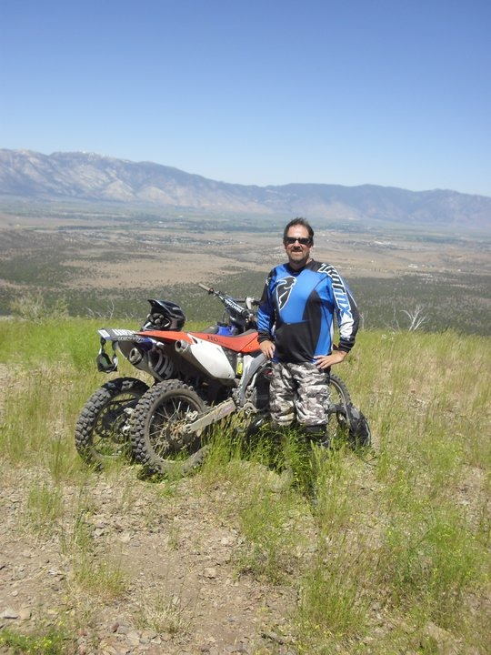 Monte Colburn standing in front of his bike