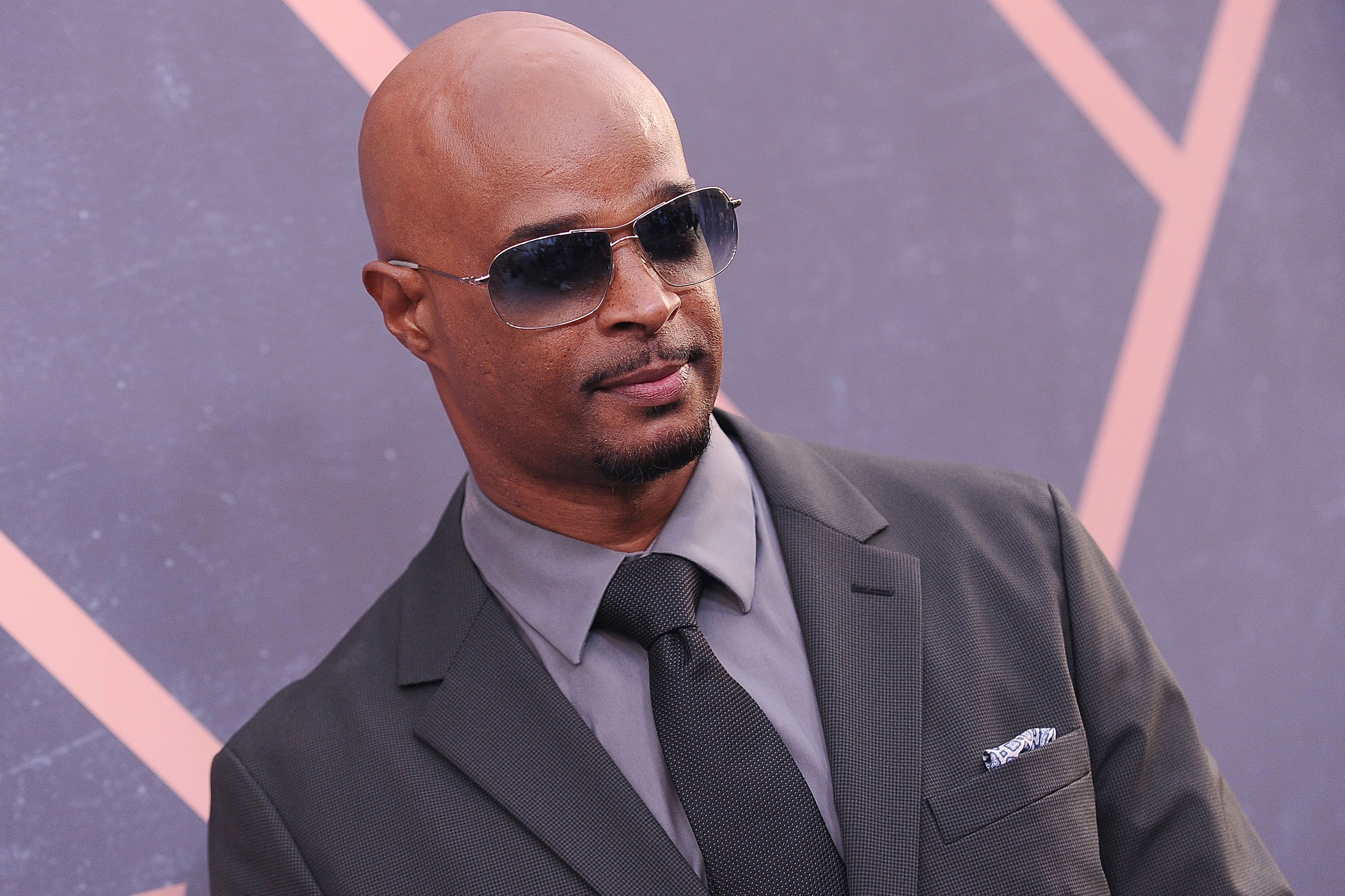 Damon Wayans posing for a picture wearing shades