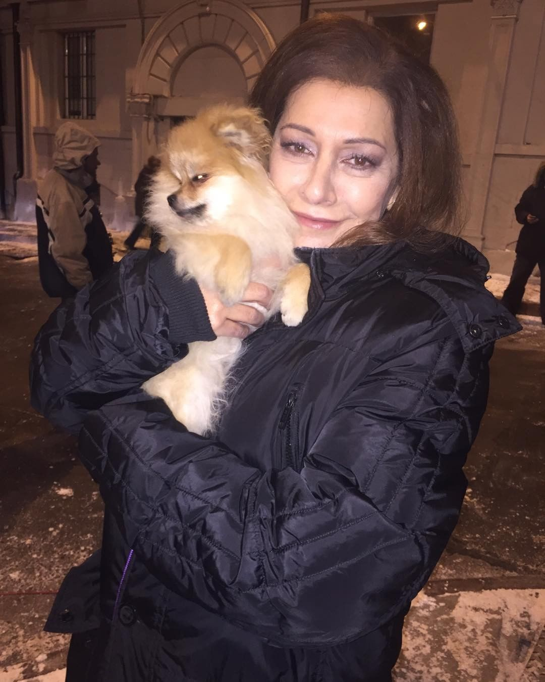 Marina Sirtis is carrying a puppy