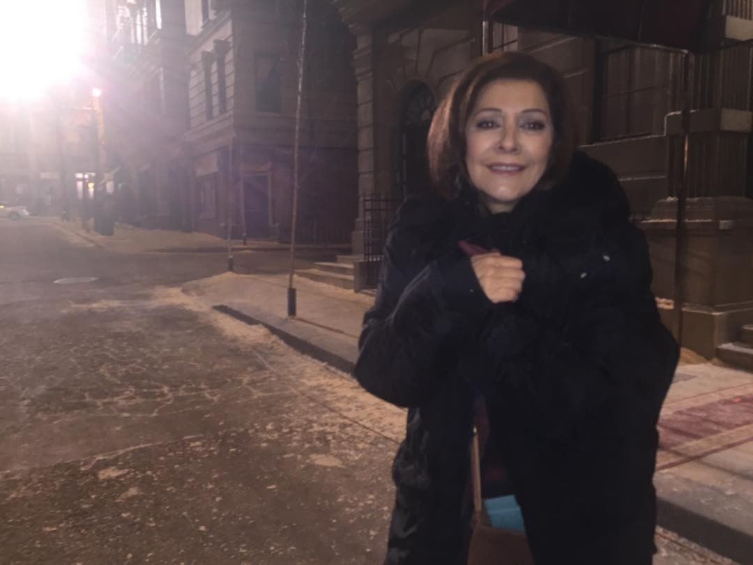 Marina Sirtis is wearing a black jacket