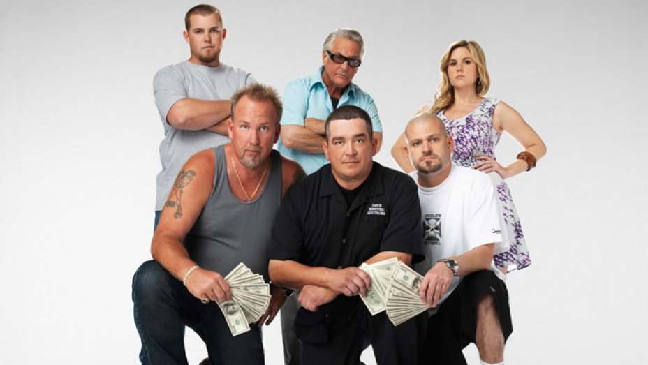 Storage Wars cast holding money in their hands