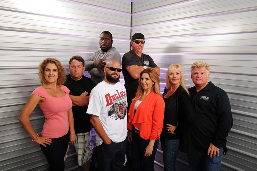 Storage Wars cast all standing with their signature poses