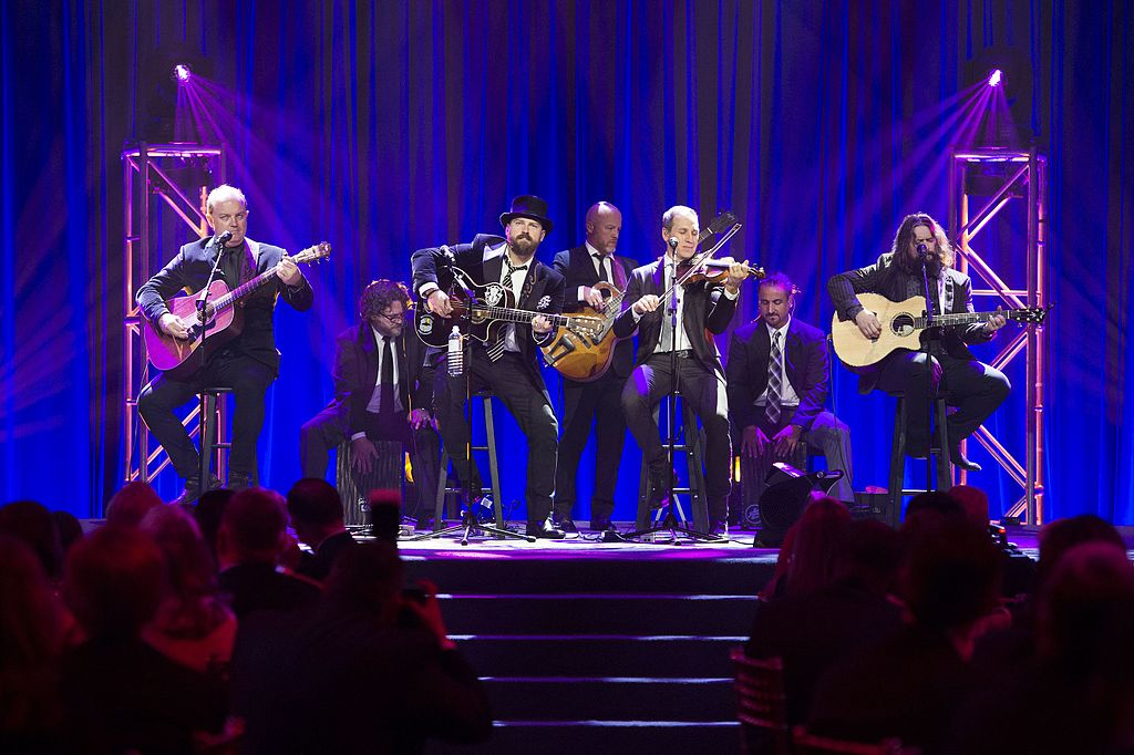 Members of Zac Brown Band performing on a stage