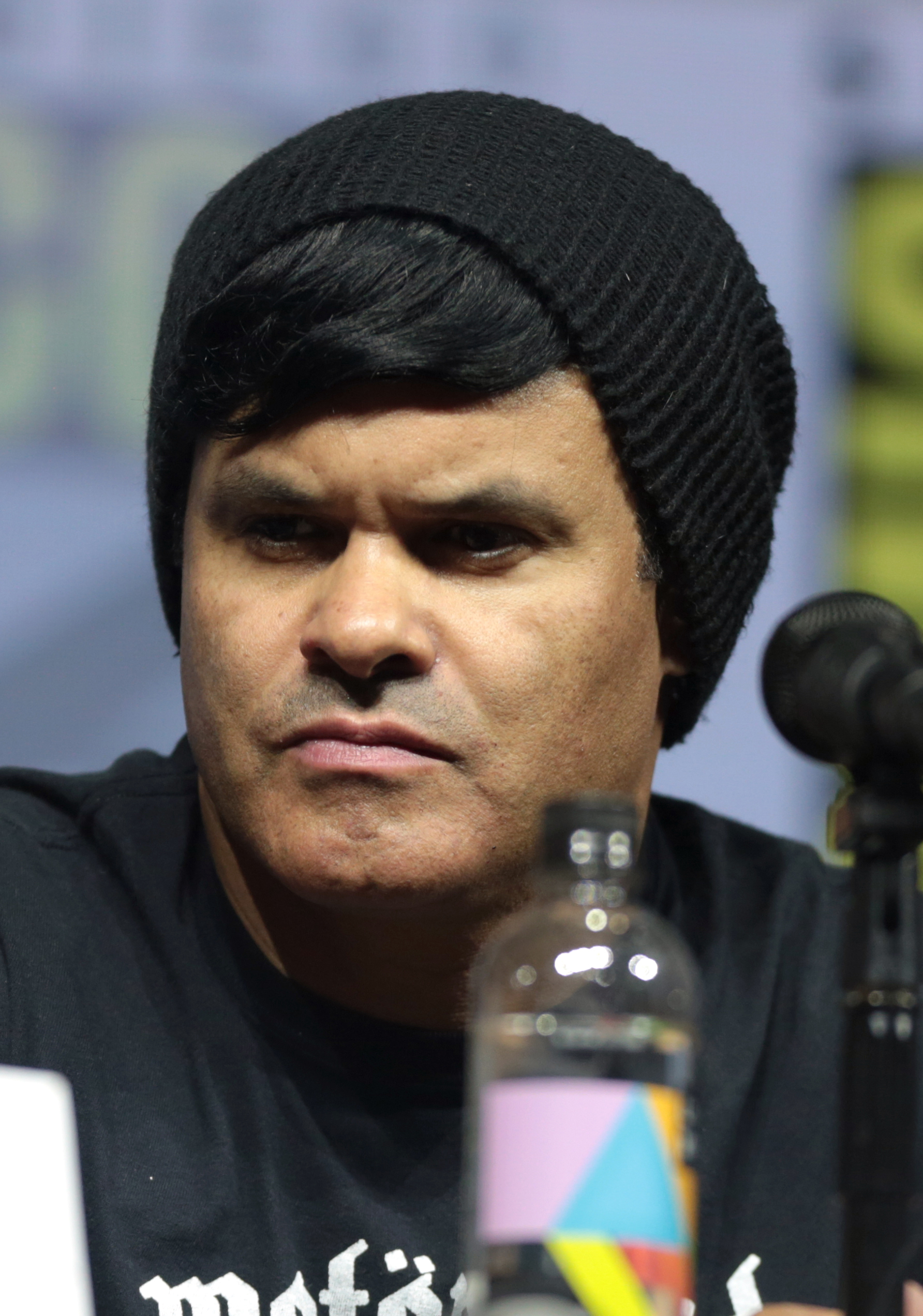 Elgin James is wearing a black colored beanie