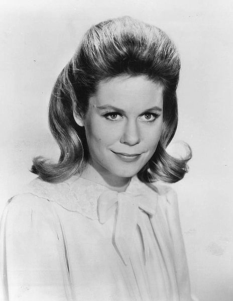 Young Elizabeth Montgomery looks great in the black and white portrait with a short hair and white dress