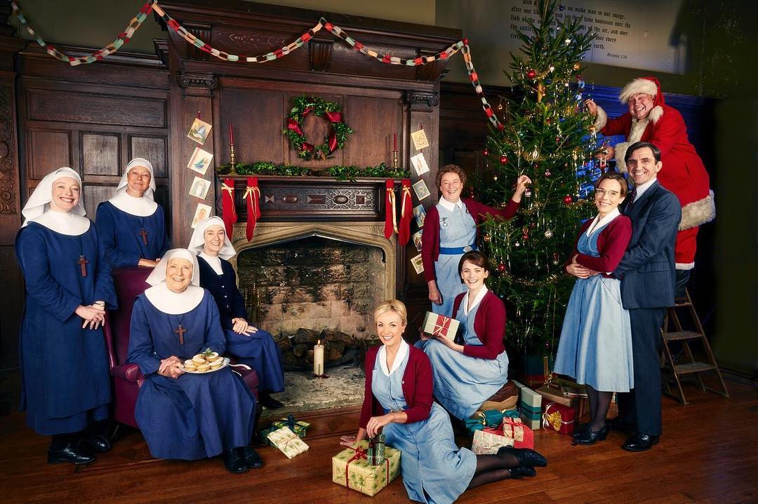 Call the Midwife cast working on the Christmas tree and decorations
